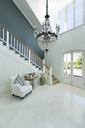 Chandelier hanging over elegant foyer - CAIF03681