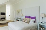 Bed in luxury bedroom - CAIF03687