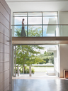 Woman on modern elevated walkway - CAIF03693