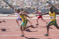 Blurred view of relay runners in race - CAIF03726