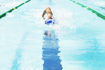 Swimmer racing in pool - CAIF03738