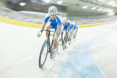 Track cycling team riding around velodrome - CAIF03756