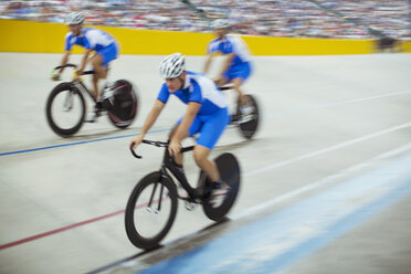 Track cycling team riding in velodrome - CAIF03768