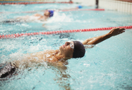 Swimmers racing in backstroke in pool - CAIF03795