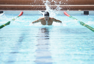 Swimmer racing in pool - CAIF03798