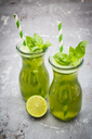 Two glasses of organic lime lemonade with basil - LVF06757