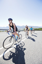 Cyclists in race on rural road - CAIF03850