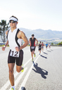 Runners in race on rural road - CAIF03853