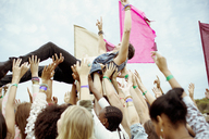 Man crowd surfing at music festival - CAIF03892