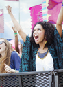Woman cheering at music festival - CAIF03919