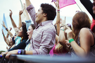 Fans cheering at music festival - CAIF03937