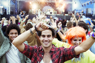 Portrait of fans dancing and cheering at music festival - CAIF03946