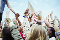 Fans reaching to shake hands with performer at music festival - CAIF03955