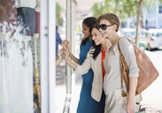 Women window shopping on city street - CAIF04004