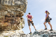Climbers examining rock formation - CAIF04103