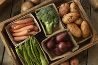 Still life fresh, organic, healthy vegetable harvest variety in wood crate - CAIF04181