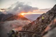 Austria, Tyrol, Innsbruck, mountaineer at Nordkette via ferrata at sunrise - CVF00243