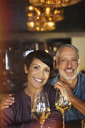 Portrait smiling couple drinking white wine in bar - HOXF00015