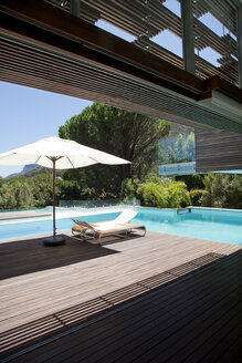 Swimming pool, lounge chair, umbrella - CAIF04413