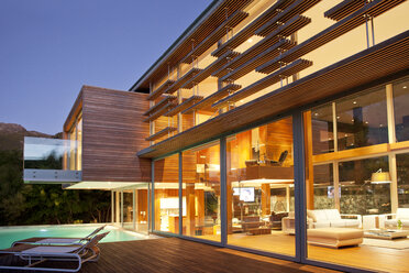 Swimming pool and modern house at night - CAIF04416