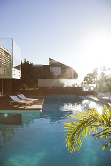 Sun shining over modern house and swimming pool - CAIF04422