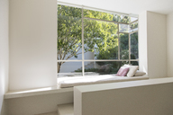 Window seat overlooking trees - CAIF04512