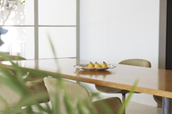 Pears in dish on dining room table - CAIF04524