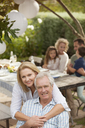 Portrait of smiling senior couple on patio - CAIF04530
