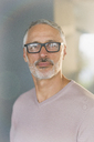 Portrait confident businessman with beard and eyeglasses - HOXF00411