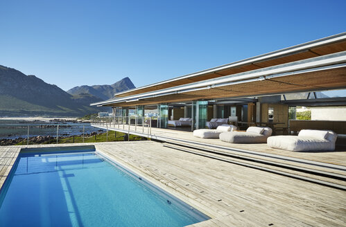 Modern luxury hotel swimming pool under sunny blue sky - HOXF00495