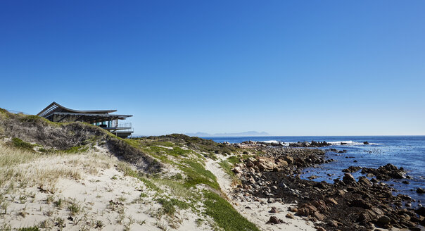 House with ocean view under sunny blue sky - HOXF00501
