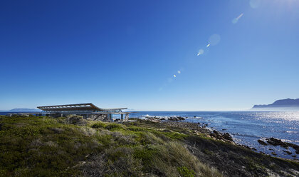 Luxury house with ocean view under sunny blue sky - HOXF00504