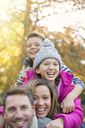 Portrait enthusiastic family hugging outdoors - HOXF00639