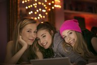 Portrait smiling teenage girls using digital tablet - HOXF00678