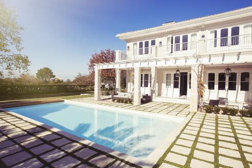Swimming pool outside luxury house - HOXF00762