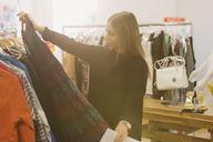 Fashion buyer examining skirt - HOXF00912