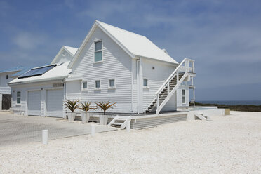 White beach house under sunny blue sky - HOXF00945