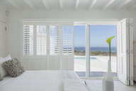 White bedroom home showcase open to swimming pool and ocean view - HOXF00960