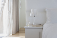 White lamp and bedside table in home showcase bedroom - HOXF00981