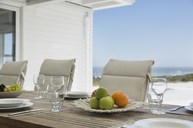 Placesettings on beach house patio table - HOXF00987