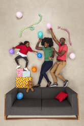 Little daughter celebrating birthday party, dancing with her parents - BAEF01582