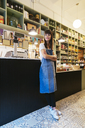 Smiling woman standing in a store - EBSF02211