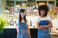 Portrait of two smiling women in a store - EBSF02214