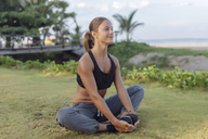 Indonesia, Bali, woman stretching - KNTF01065