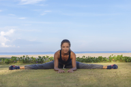 Indonesia, Bali, woman stretching - KNTF01068