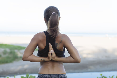 Indonesia, Bali, woman stretching arms - KNTF01077