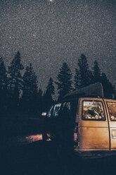 Canada, British Columbia, Chilliwack, starry sky and illuminated minivan at night - GUSF00307