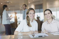 Portrait smiling, confident businesswomen in conference room meeting - HOXF01202