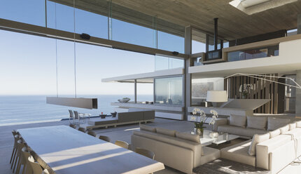 Modern, luxury home showcase interior living room and dining room with ocean view - HOXF01253