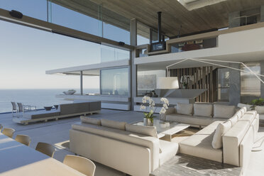 Modern, luxury home showcase interior living room with ocean view - HOXF01256